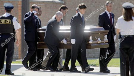 The casket of Christopher Kelly, ousted Illinois Gov., Rod Blagojevich's former chief fundraiser leaves the church, in Western Springs, Ill. Kelly died Saturday, Sept. 12 of a suspected overdose, less than a week after he was due to enter prison to begin serving a three-year sentence for tax fraud