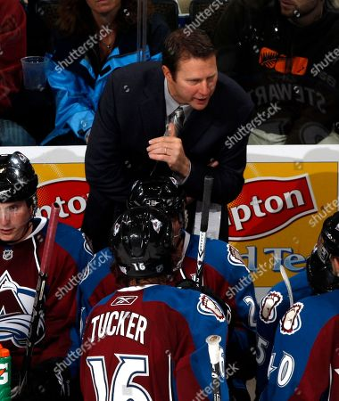 Joe Sacco Colorado Avalanche head coach Joe Sacco, back, directs his team against the Vancouver Canucks in the third period of the Avalanche's 3-0 victory in a hockey game in Denver on