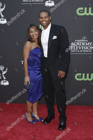 Texas Battle Texas Battle and guest arrive at the Daytime Emmy Awards, in Los Angeles