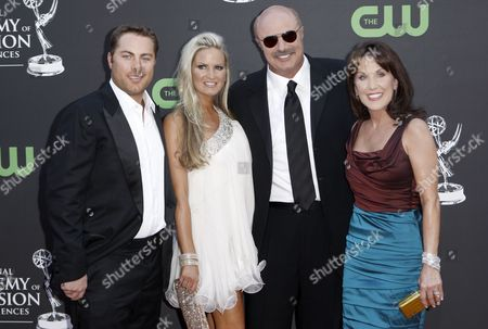 Jay McGraw, Erica Dahm, Phil McGraw, Robin McGraw From left, Jay McGraw, Erica Dahm, Phil McGraw and Robin McGraw arrive at the Daytime Emmy Awards, in Los Angeles