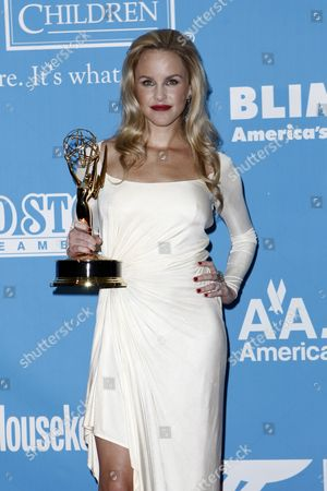 Julie Berman Actress Julie Berman holds the award for outstanding younger actress in a drama series backstage at the Daytime Emmy Awards, in Los Angeles