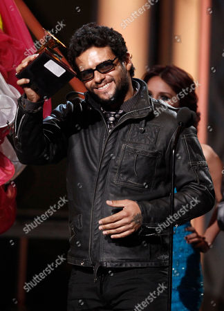 "Robi Draco Rosa Singer Robi ""Draco"" Rosa accepts the best rock solo vocal album at the 10th Annual Latin Grammy Awards in Las Vegas. After surviving a cancer called 'Non Hodgkins Lymphoma', Draco will begin his first U.S. tour in October, announced his representative on"