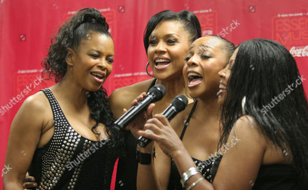 "En Vogue, members including from left: Dawn Robinson, Cindy Herron-Bragg, Terry Ellis and Maxine Jones, sing ""Hold On"" for member of the press during interviews after performing at the Essence Music Festival in New Orleans, . Essence celebrates its 15th year and En Vogue marked their 20th anniversary"