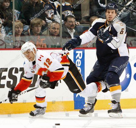 Jarome Iginla, Shea Weber Calgary Flames right wing Jarome Iginla (12) and Nashville Predators defenseman Shea Weber (6) chase the puck in the first period of an NHL hockey game, in Nashville, Tenn