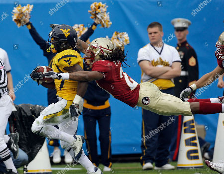 Noel Devine, Patrick Robinson West Virginia running back Noel Devine runs for a second-quarter touchdown as Florida State cornerback Patrick Robinson attempts to make the tackle during the Gator Bowl NCAA college football game, in Jacksonville, Fla
