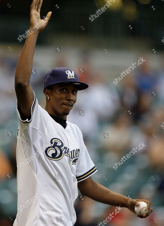 Brandon Jennings Milwaukee Bucks first round draft pick Brandon Jennings throws out the ceremonial first pitch before the first inning of a baseball game between the Milwaukee Brewers and San Francisco Giants, in Milwaukee