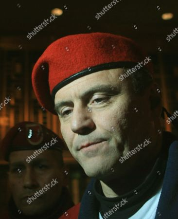 "Curtis Sliwa Guardian Angels founder Curtis Sliwa reacts as he leaves federal court in Manhattan after jurors remained deadlock in the racketeering trial against John ""Junior"" Gotti in New York, . This is Gotti's fourth trial, the previous three declared mistrials, and each time prosecutors renew accusations that Gotti orchestrated a kidnapping and attempted murder plot against Sliwa"