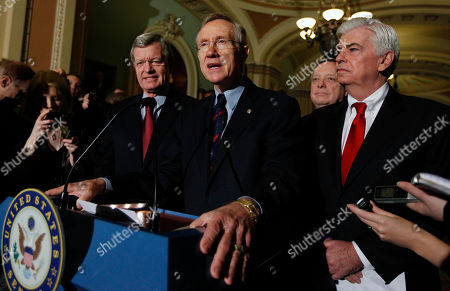 Harry Reid, Max Baucus, Richard Durbin, Christopher Dodd Senate Majority Leader Harry Reid of Nev., center, answers questions outside of the Senate chambers on Capitol Hill in Washington, after the Senate passed the health care reform bill. From left are, Senate Finance Finance Committee Chairman Sen. Max Baucus, D-Mont., Reid, Senate Majority Whip Richard Durbin of Ill., and Senate Banking Committee Chairman Sen. Christopher Dodd, D-Conn