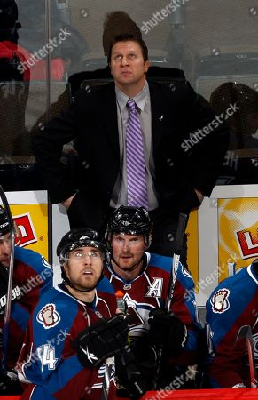 Joe Sacco Colorado Avalanche head coach Joe Sacco, back, looks on against the Carolina Hurricanes in the third period of the Avalanche's 5-4 victory in a hockey game in Denver on