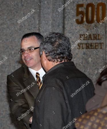 "Gotti John ""Junior"" Gotti smiles as he greets a family member outside U.S. District Court in Manhattan after a mistrial was declared in his racketeering trial in New York, . A judge declared a mistrial after a jury failed to reach a verdict against the son of the notorious Gambino crime family and mob boss--the case's fourth hung jury in five years"