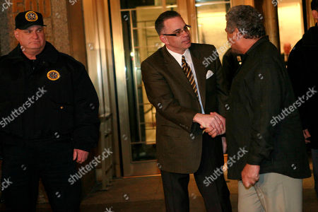 "Gotti John ""Junior"" Gotti, shakes the hand of an unidentified man as he leaves Manhattan federal court, in New York. A judge declared a mistrial Tuesday at the racketeering trial of John ""Junior"" Gotti after a jury failed to reach a verdict against the son of the notorious Gambino crime family mob boss - the case's fourth hung jury in five years"