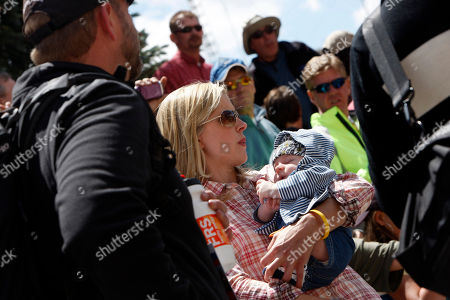 Max Armstrong, Anna Hansen Ten-week-old Max Armstrong, right, son of Lance Armstrong of Aspen, Colo., is held by mother Anna Hansen as they wait at the Leadville Trail 100 mountain bicycle race in Leadville, Colo., on