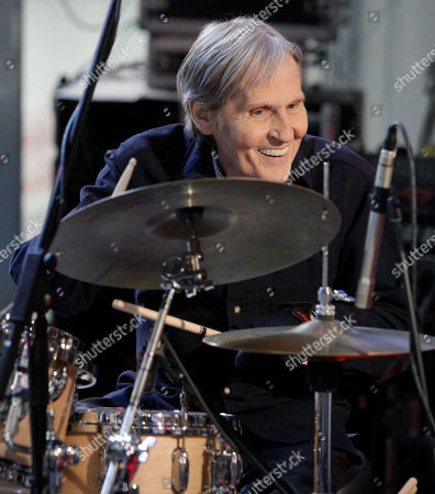 "Levon Helm Levon Helm, right, performs with his band on the ""Imus in the Morning"" program on the Fox Business channel, in New York. The influential Grammy-winning singer and drummer for The Band died of throat cancer earlier this year at age 71. John Mayer, Gregg Allman, Dierks Bentley and several other musicians are getting together to pay tribute to the late Levon Helm. The ""Love for Levon"" benefit concert will be held Oct. 3 at the Izod Center in East Rutherford, N.J"