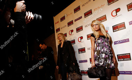 """Paris Hilton Paris Hilton arrives at the book party for Mark Liddell's """"EXPOSED: 10 Years in Hollywood"""" in Los Angeles on"""