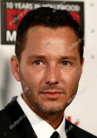 """Mark Liddell Photographer Mark Liddell arrives at the party for his book """"EXPOSED: 10 Years in Hollywood"""" in Los Angeles on"""