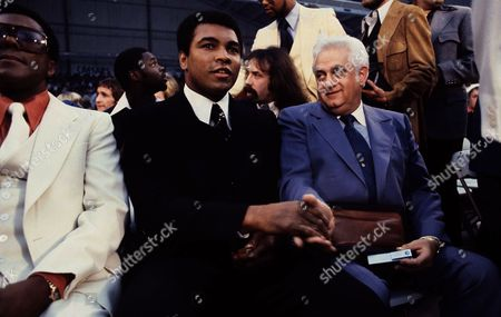 Muhammad Ali heavyweight boxing champ shown attending the Ken Norton-Jimmy Young fight in October 1977. No other caption information available