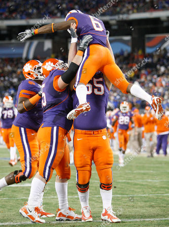 Jacoby Ford, Dalton Freeman, Thomas Austin Clemson wide receiver Jacoby Ford (6) is picked up by Dalton Freeman, right, and Thomas Austin, second from left, after Ford scored a touchdown on a 32-yard pass play against Kentucky in the first quarter of the Music City Bowl NCAA college football game, in Nashville, Tenn