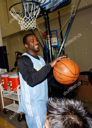 Ty Lawson Denver Nuggets rookie guard Ty Lawson works with some of the 70 children from Denver Public Schools in a basketball clinic in Denver on . The students were chosen to attend the clinic with Lawson as well as veteran forward Malik Allen as a reward for their efforts in the classroom