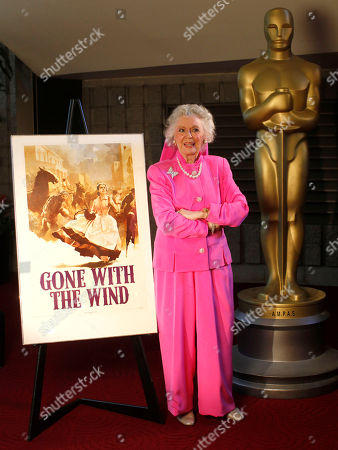 """Ann Rutherford Actress Ann Rutherford, known as Carreen O'Hara in """"Gone with the Wind,"""" pose for a photograph at the Grand Lobby of the Academy of Motion Pictures Arts and Sciences, in Los Angeles"""