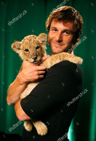 """Dave Salmoni Dave Salmoni who is Animal Planet's large predator expert, poses with a lion cub named Shera in New York, . Salmoni's new show """"Into the Pride"""" premieres this week"""