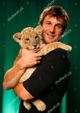 """Dave Salmoni Dave Salmoni who is Animal PlanetÕs large predator expert, poses with a lion cub named Shera in New York, . SalmoniÕs new show """"Into the Pride"""" premieres this week"""