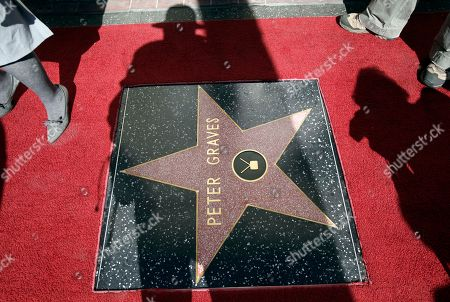 """Peter Graves Journalists photograph actor Peter Graves' star on the Hollywood Walk of Fame after dedication ceremonies n Los Angeles . His movie career spanned classics such as """"Stalag 17"""" to comedies such as """"Airplane!"""", but he is best remembered by many as the head of the """"Mission: Impossible"""" force in the 1960s and 70s"""