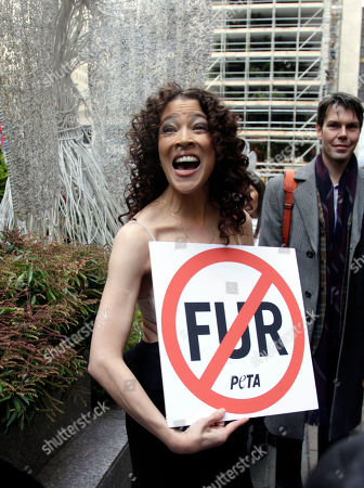 Tai Babilonia Former Olympic figure skater Tai Babilonia carries an anti-fur sign from the People for the Ethical Treatment of Animals, PETA, after she skated on the Rockefeller Center rink in New York