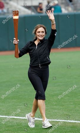 Peggy Fleming Olympic gold medalist figure skater Peggy Fleming waves before a baseball game between the Philadelphia Phillies and the San Francisco Giants in San Francisco