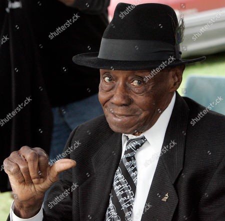 """Joe Willie """"Pinetop"""" Perkins Grammy winning blues pianist Joe Willie """"Pinetop"""" Perkins motions a """"thumbs up"""" gesture during the annual festival at Hopson Plantation in Clarksdale, Miss. Perkins, 97, broke the record of oldest Grammy winner when he snagged a Grammy for best traditional blues album for """"Joined at the Hip: Pinetop Perkins & Willie """"Big Eyes"""" Smith. He had tied with George Burns in 2004, said his manager, Patricia Morgan"""