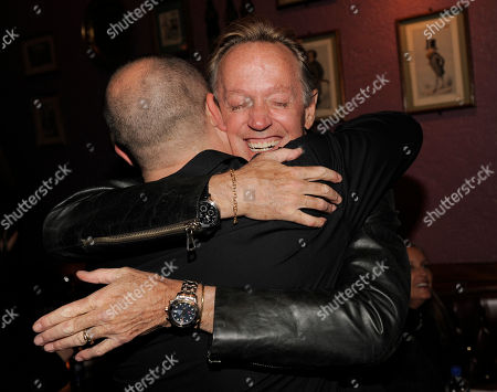 "Peter Fonda, Troy Duffy Peter Fonda, a cast member in ""The Boondock Saints II: All Saints Day,"" hugs the films writer/director Troy Duffy at the post-premiere party for the film in Los Angeles"