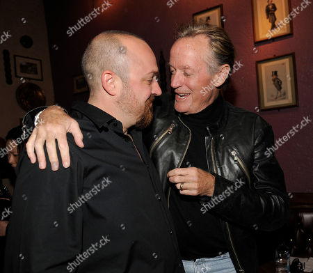 "Troy Duffy, Peter Fonda Troy Duffy, left, writer/director of ""The Boondock Saints II: All Saints Day,"" mingles with cast member Peter Fonda at the post-premiere party for the film in Los Angeles"