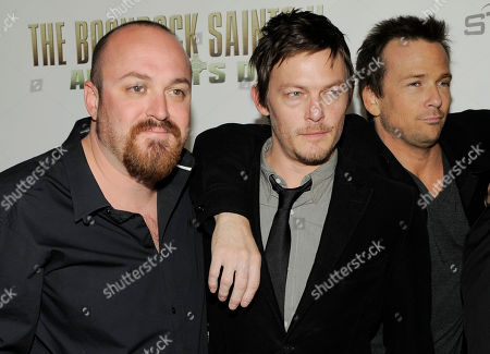 "Troy Duffy, Sean Patrick Flanery, Norman Reedus Troy Duffy, left, writer/director of ""The Boondock Saints II: All Saints Day,"" poses with cast members Norman Reedus, center, and Sean Patrick Flanery at the premiere of the film in Los Angeles"