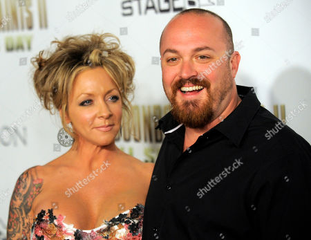 "Troy Duffy Troy Duffy, right, writer/director of ""The Boondock Saints II: All Saints Day,"" poses his wife Angela at the premiere of the film in Los Angeles"