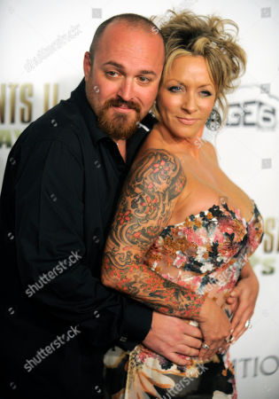 "Troy Duffy Troy Duffy, left, writer/director of ""The Boondock Saints II: All Saints Day,"" poses his wife Angela at the premiere of the film in Los Angeles"