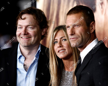 """Brandon Camp, Jennifer Aniston, Aaron Eckhart Director and co-writer Brandon Camp, left, and cast members Jennifer Aniston, center, and Aaron Eckhart pose together at the premiere of """"Love Happens"""" in Los Angeles on"""