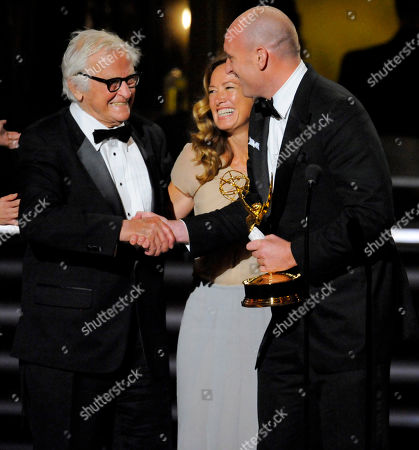 "Albert Maysles, Patricia Rozema, Michael Sucsy From left, ""Grey Gardens"" filmmaker Albert Maysles, writer Patricia Rozema and, director Michael Sucsy accept the award for best made for television movie at the 61st Primetime Emmy Awards, in Los Angeles"