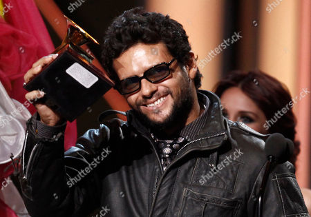 Robi Draco Rosa Robi Draco Rosa accepts the best rock solo vocal album at the 10th Annual Latin Grammy Awards in Las Vegas