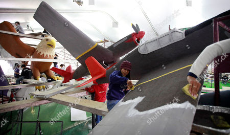 """Sally Murphy Volunteer Sally Murphy, center, works on a float named """"Tuskegee Airmen"""" in Pasadena, Calif., in preparation for the Rose Parade"""
