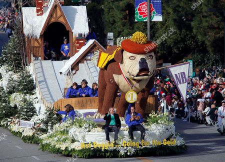 Dick Van Patten front left, rides on the front of the Dick Van Patten's Natural Balance Pet Foods, Inc. float as it moves along Colorado Blvd. during the 121st Rose Parade in Pasadena Calif., on