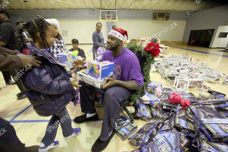 Shaquille O'Neal Cleveland Cavaliers' Shaquille O'Neal gives out Christmas toys to children at Challengers Boys & Girls Club in Los Angeles, on