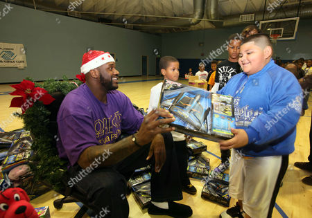 Shaquille O'Neal Cleveland Cavaliers' Shaquille O'Neal gives a Christmas toy to Jesus Sedano, 8, at Challengers Boys & Girls Club in Los Angeles, on