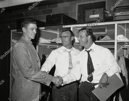 Stan Musial, Von McDaniel, Wally Moon Seven-time National League batting champ Stan (The Man) Musial and Wally Moon, center, bid farewell to 18-year-old Von McDaniel, St. Louis Cardinal rookie pitching sensation in September 1957. Musial and McDaniel were given the rest of the season off. McDaniel will attend college. Seven other Red Birds also were excused for the season. Stan sewed up the 1957 National League batting championship with a 351 mark and played down the stretch with an injured shoulder