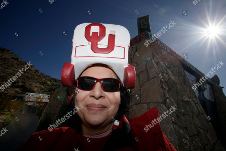 Stock Image of Jessica Santiago Jessica Santiago, whose daughter is a student at Oklahoma, wears a hat as she heads to watch the Sun Bowl between Stanford and Oklahoma in El Paso, Texas