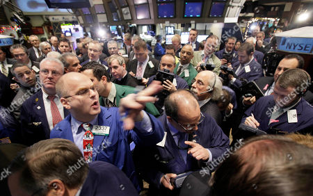 Evan Solomon Specialist Evan Solomon, foreground left, prepares to open Citigroup's secondary offering shares on the floor of the New York Stock Exchange . Citi is the last remaining Wall Street bank in which the government still owns a major stake