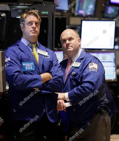Patick Murphy, Evan Solomon Specialists Patrick Murphy, left, and Evan Solomon work on the floor of the New York Stock Exchange