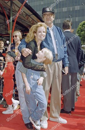 Walter Matthau, Lea Thompson Stars of the new movie ?Dennis the Menace? Walter Matthau, right, who plays Mr. Wilson, Lea Thompson, who plays Alice Mitchell, and seven-year-old Mason Gamble, who plays the title role, pose during a special industry screening in Los Angeles in an undated photo