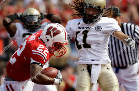 Wisconsin's Erik Smith breaks away from Wofford's Mychael Johnson for a touchdown during the first half of an NCAA football game, in Madison, Wis