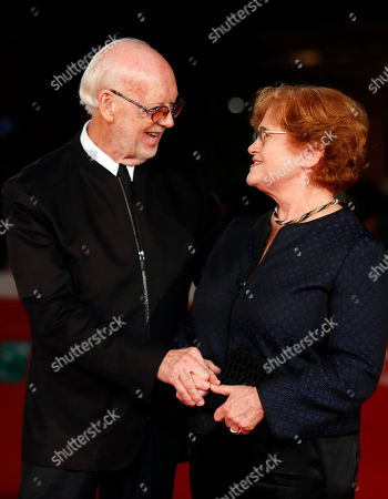 Director Mick Jackson, left, and American historian and author Deborah Lipstadt pose for photographers on the red carpet on the occasion of the screening of the movie ' Denial ' at the Rome Film festival in Rome