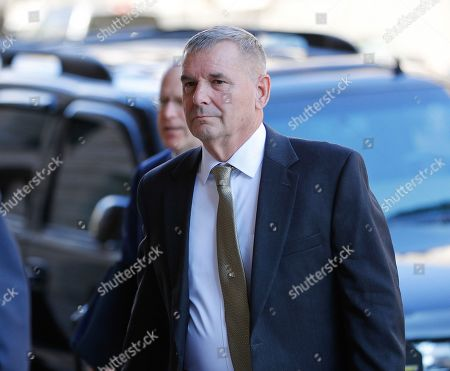 Retired Marine Gen. James Cartwright arrives at US District Court in Washington, . Cartwright has been charged with making false statements during a federal investigation into a leak of classified information, the Justice Department announced