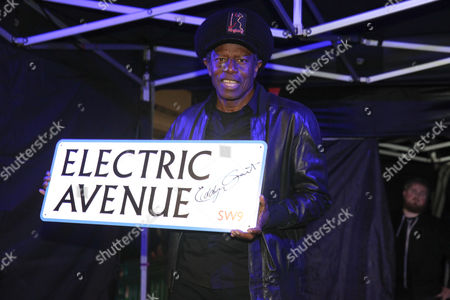 Eddy Grant switches on the illuminated Electric Avenue sign in Brixton